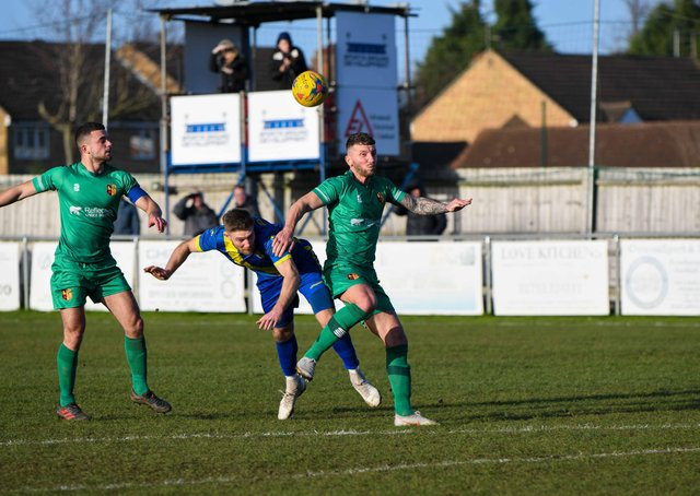 Mark Jones (blue) in action for Peterborough Sports in their weekend win over Alvechurch. Photo: James Richardson.