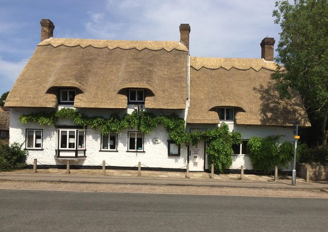 The Cherry House at Werrington, with its new thatch