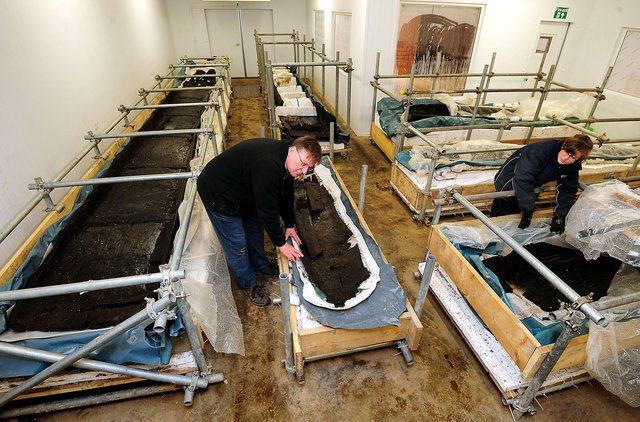 Bronze Age longboats discovered at Must Farm being stored at Flag Fen. Photo: Rui Vieira/PA Wire ENGEMN00120130306082333