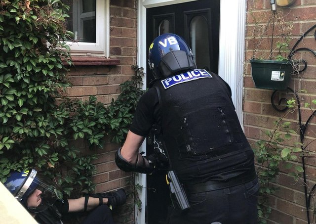 Police taking part in the raid in Cambridge. Pic: Cambs Police