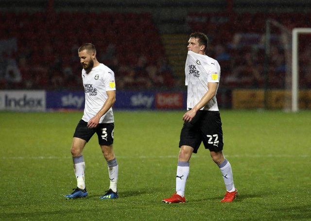Ethan Hamilton of Peterborough United (right)  leaves the pitch dejected at full-time alongside Dan Butler. Photo: Joe Dent/theposh.com/