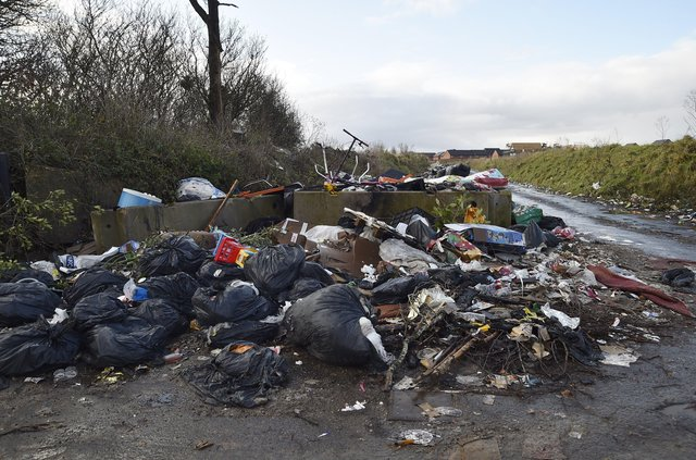 Fly-tipping on Norwood Lane at the junction with Newborough Road EMN-210401-132355009