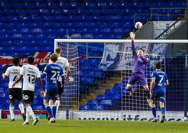Posh goalkeeper Christy Pym tips a shot from Ipswich substitute Jon Nolan over the crossbar. Photo: Joe Dent/theposh.com.
