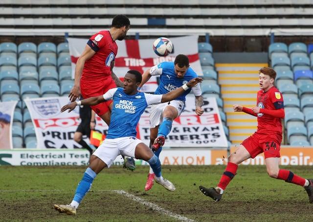 Jonson Clarke-Harris of Peterborough United heads in the equalising goal against Wigan Athletic. Photo: Joe Dent/theposh.com.