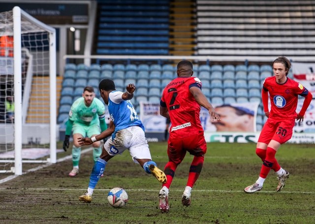 Posh star Siriki Dembele goes down to earn his side a match-winning penalty against Wigan. Photo: Joe Dent/theposh.com.