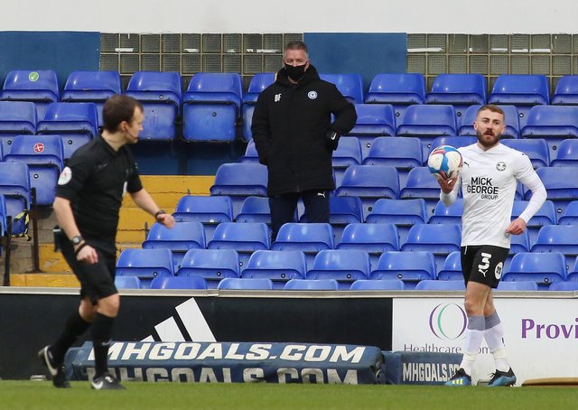 Posh boss Darren Ferguson watches on from the stand as Dan Butler prepares to take a throw-in.