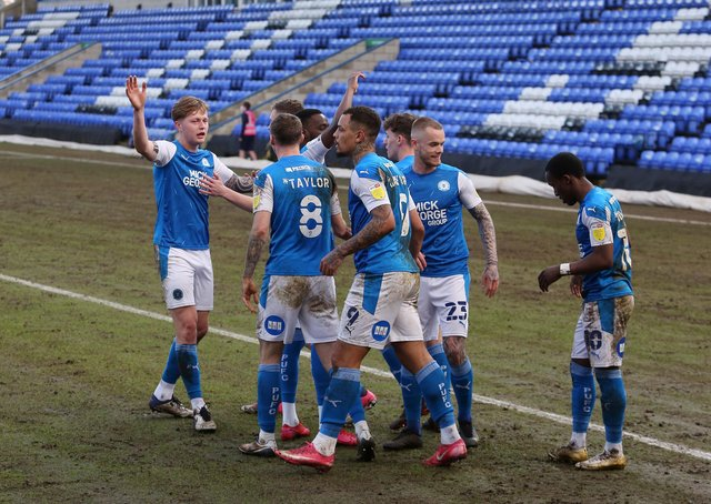 Posh players celebrate the winning goal against Wigan at the weekend. Photo: Joe Dent/thposh.com.