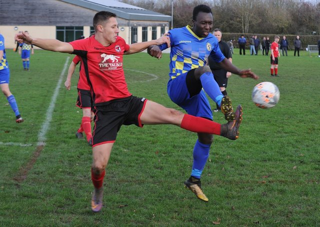 Action from Stilton United (red) v Peterborough North End Sports