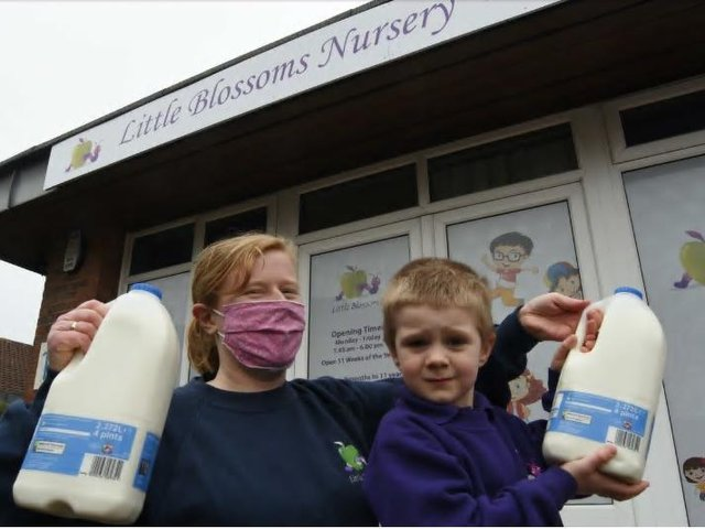 Charlotte Tuffs, deputy manager of Little Blossoms Nursery at Werrington with four-year-old Alfie and some of the milk donated by Tesco following a milk theft at the nursery
