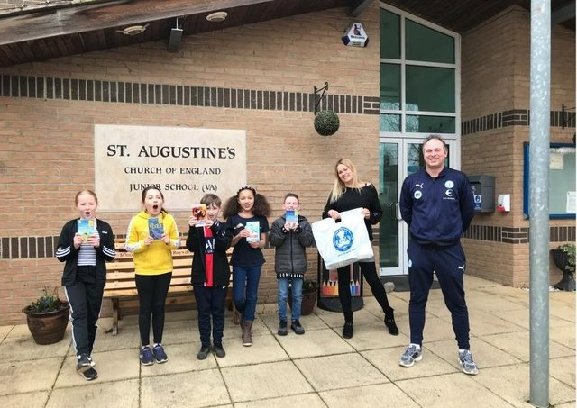 Gavin Slater, Community Manager at Peterborough United Foundation presenting free World Book Day books.
