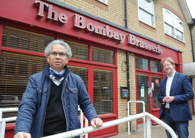 Rony Choudhury owner of the Bombay Brasserie, Broadway, outside his restaurant with Peterborough MP Paul Bristow.