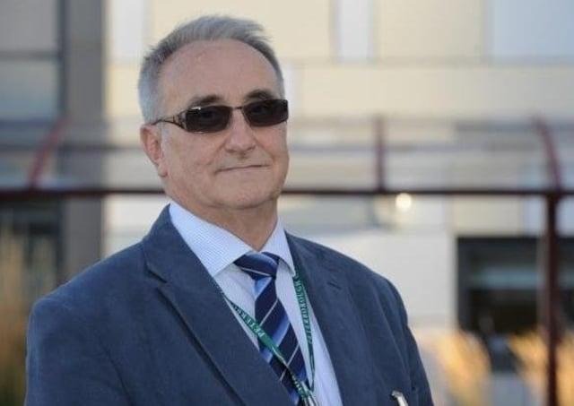 Retiring city council leader John Holdich.