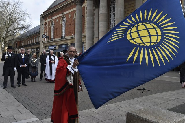 Raising of the Commonwealth flag last year outside Peterborough Town Hall by Mayor of Peterborough cllr. Gul Nawaz EMN-200903-140451009