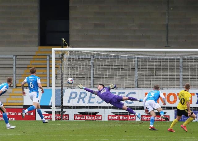Christy Pym of Peterborough United makes a diving save against Burton Albion - Mandatory by-line: Joe Dent/JMP - 06/03/2021 - FOOTBALL - Pirelli Stadium - Burton-upon-Trent, England - Burton Albion v Peterborough United - Sky Bet League One
