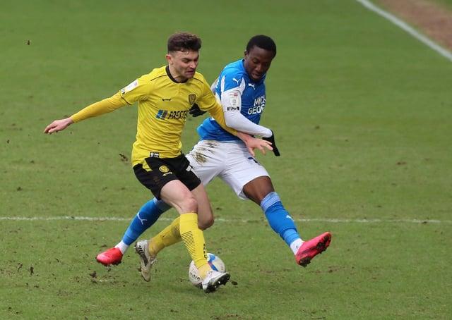 Siriki Dembele of Peterborough United puts pressure on Jonny Smith of Burton Albion. Photo: Joe Dent/theposh.com.