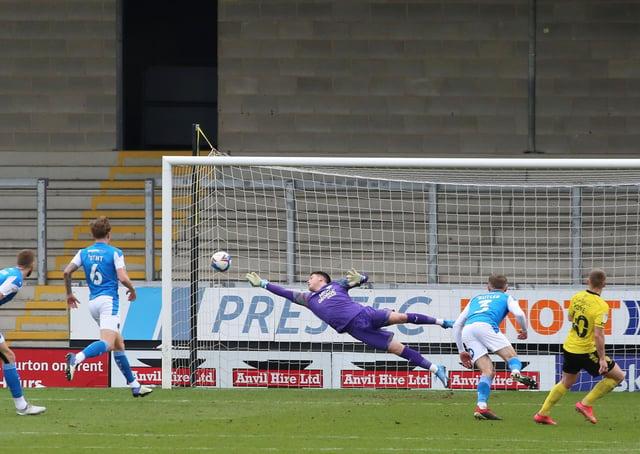 Christy Pym of Peterborough United makes a diving save against Burton Albion. Photo: Joe Dent/theposh.com.