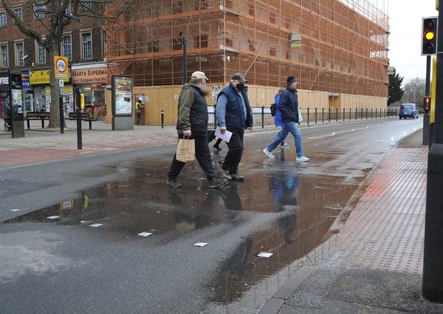 Flooded pedestrian crossing on Bridge Street.