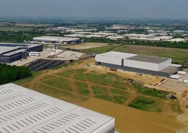Aerial pix of new factories going up at Alwalton Hill. EMN-200905-170529009