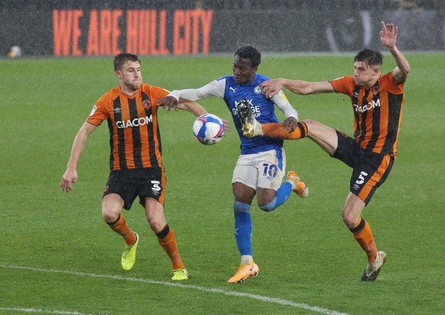 Siriki Dembele in action for Posh at Hull City earlier this season.