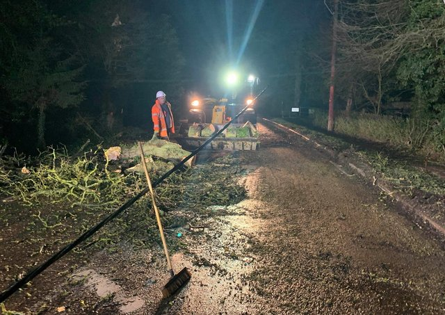 Teams worked overnight to reopen Dowgate Road near Leverington after a tree brought down power cables. Pic: Cambs Police