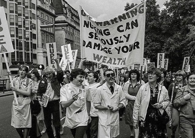 Health staff marching from the then Peterborough District Hospital in a protest over pay.