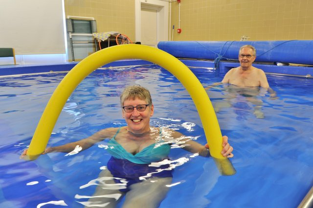 Sue Moore and Walter McCombe using the pool after it was refurbished. EMN-171017-153627009