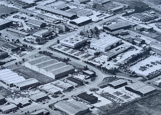 This aerial shot is a view of one of the least glamorous (but very important in terms of jobs and the local economy) parts of the city – Vicarage Farm Road. It was  one the first  industrial parks created in the city being home to many light industrial units and played a key part in the city's New Town growth period.