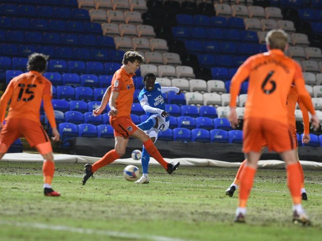 Sirki Dembele gets a shot away during the first half against Portsmouth (Pictures: David Lowndes)