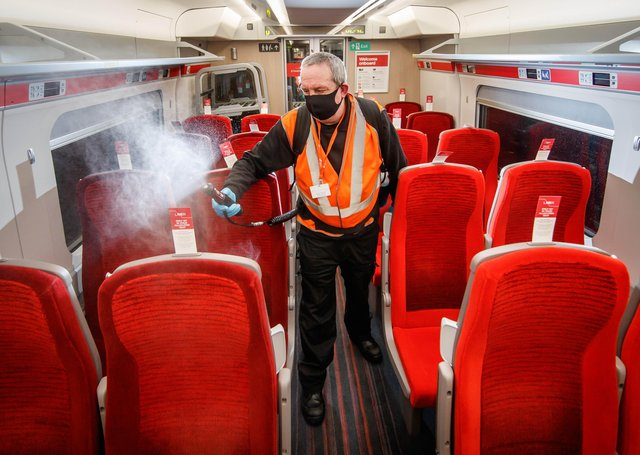A cleaner uses a fogging machine to clean a train carriage during the night, as a team of 360 specialists work around-the-clock to deliver London North Eastern Railway's 'Covid Secure' enhanced cleaning pledge to keep customers who need to make necessary journeys safe during the pandemic. PA Photo. EMN-210317-123957001