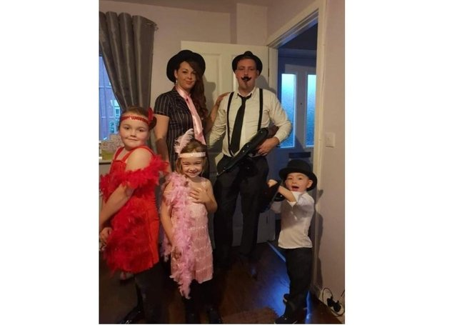Chloe Rosser with her family, husband Simon, daughters, Poppy and Ruby and son George.