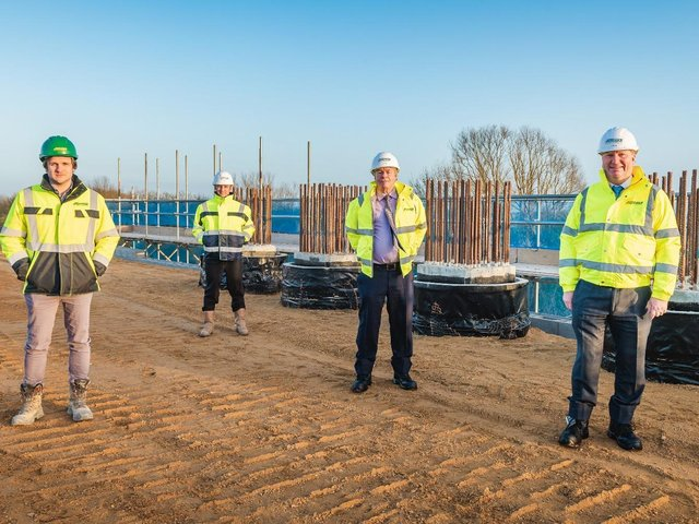 Rhydian Hafal, construction manager, Jones Bros; Lee Baldry, team leader - major projects, Cambridgeshire County Council; Cllr David Connor; and Cllr Steve Count standing on the first earth reinforced abutment.