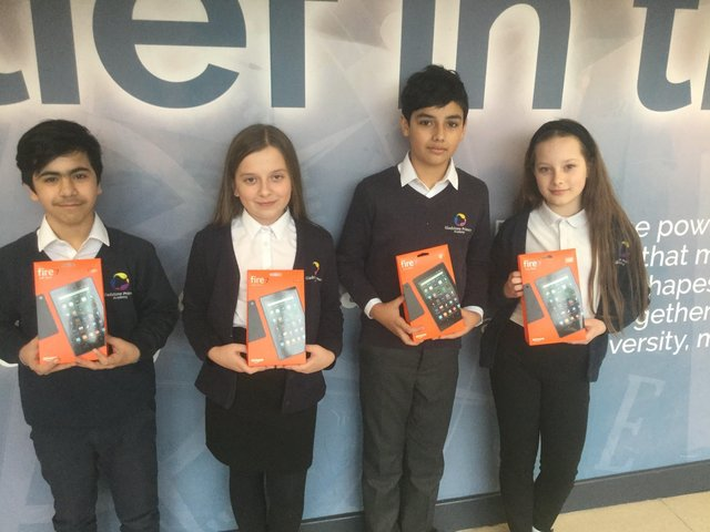 Some of the pupils with their new tablets