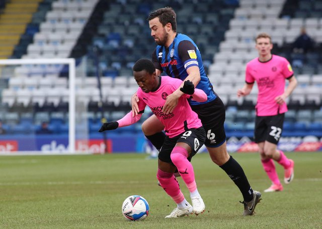 Siriki Dembele of Peterborough United is held back by Eoghan O'Connell of Rochdale. Photo: Joe Dent/theposh.com.
