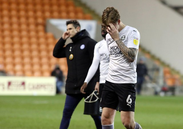 Frankie Kent of Peterborough United leaves the pitch dejected after defeat at Blackpool. Photo: Joe Dent/theposh.com.