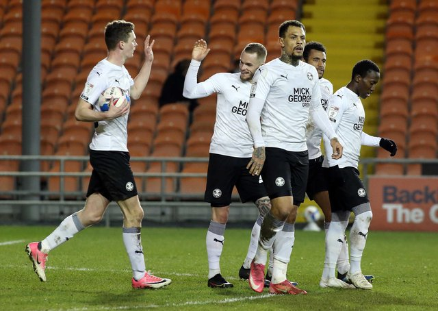 Posh players celebrate their goal against Blackpool. Photo: Joe Dent/theposh.com.
