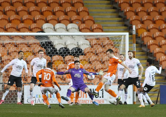 Christy Pym has just dropped a corner and Blackpool are about to win a penalty. Photo: Joe Dent/theposh.com.