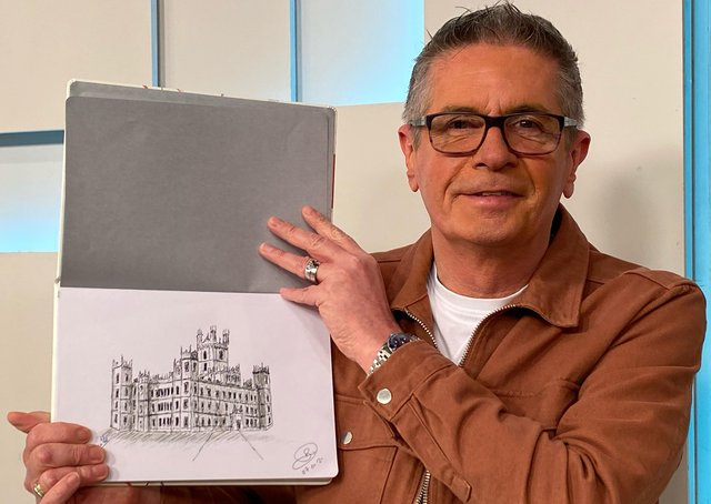 Dave Bradford with his sketch of Highclere Castle.