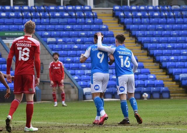 Harrison Burrows congratulates Jonson Clarke-Harris on his first goal against Accrington. Photo: David Lowndes.