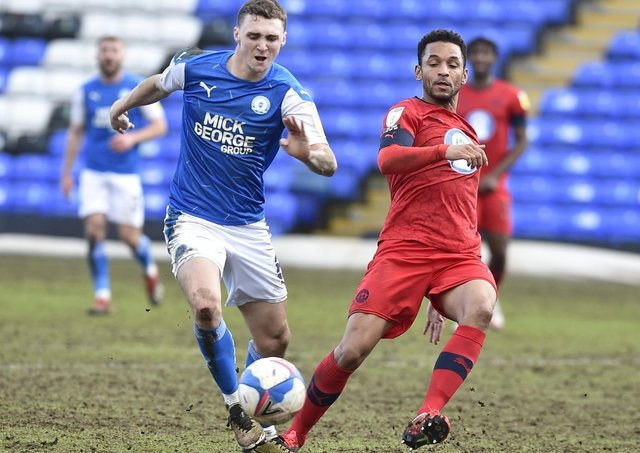 Posh midfielder Jack Taylor in action against Wigan in February.