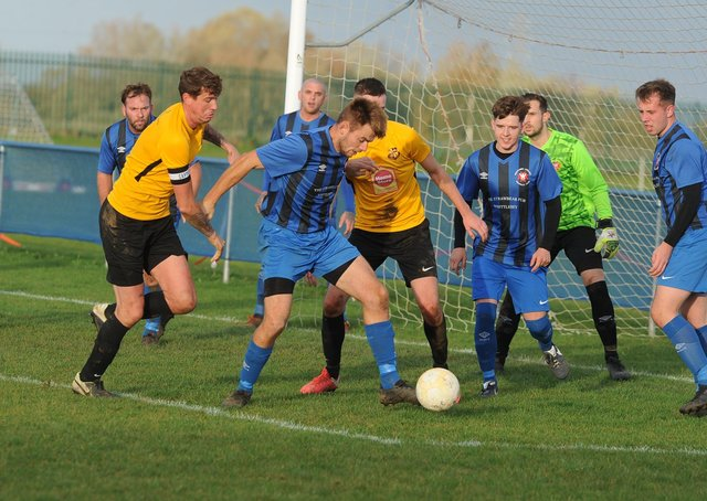 Whittlesey Athletic (blue) in action earlier this season.