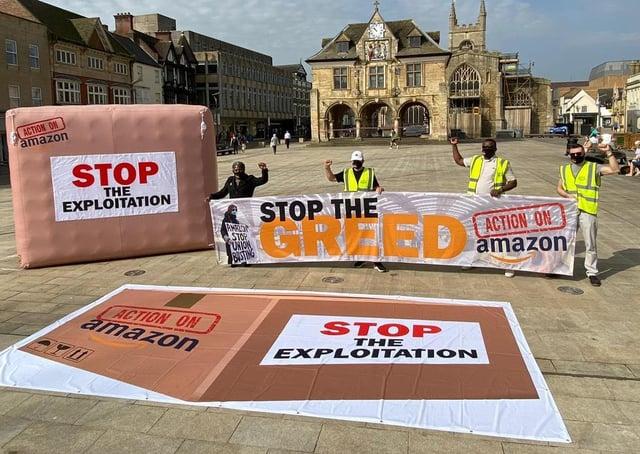 Representatives of Unite protest in Cathedral Square, in Peterborough.