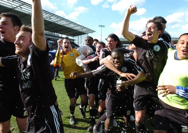 Posh players celebrate promotion from League One in 2009.
