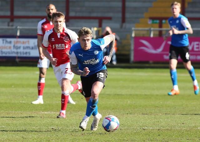 Sammie Szmodics of Peterborough United gets away from Sam Finley of Fleetwood Town. Photo Joe Dent/theposh.com