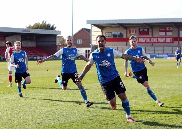 Jonson Clarke-Harris celebrates his late winning goal (Photo: Joe Dent).