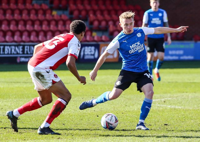 Posh midfielder Louis Reed in action with James Hill of Fleetwood Town. Photo: Joe Dent/theposh.com.
