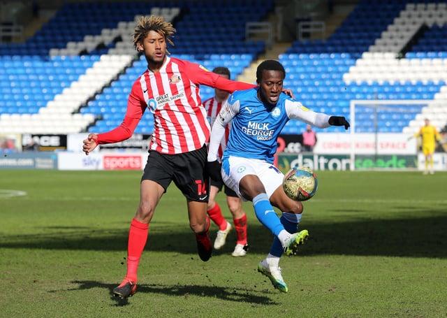 Siriki Dembele of Peterborough United in action with Dion Sanderson of Sunderland. Photo: Joe Dent/theposh.com.