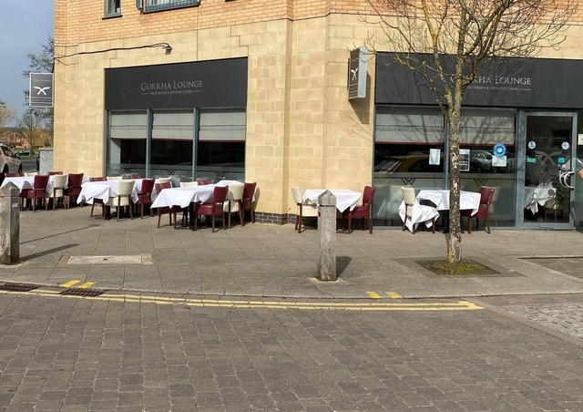 Tables and chairs outside Gurkha Lounge