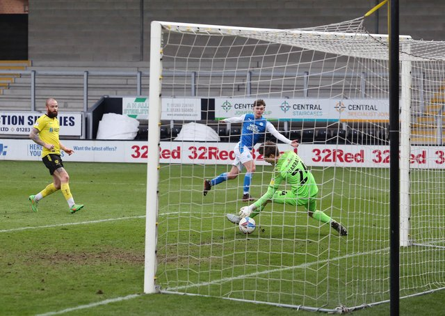 Posh teenager Harrison Burrows scores against Burton.