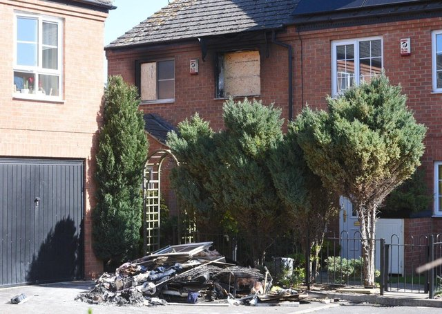 House fire in The Squires, Woodston.