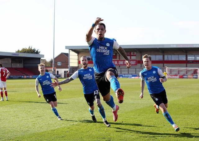 Jonson Clarke-Harris of Peterborough United celebrates a winning goal at Fleetwood on Good Friday.